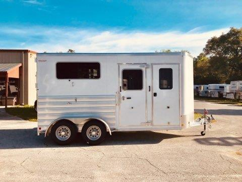 "2019 Kiefer (2) horse straight load bumper pull trailer with a tack room that is completely insulated and lined, saddle racks, bridle hooks and a camper door!  The horse area has an interior height at 7'6"" tall x 7'2"" wide x 16' long,  (2) escape doors, (2) drop down windows with drop down aluminum bars, removable divider, rubber mats over all aluminum floor and a rear ramp with dutch doors!  The exterior has two 3500lbs and a spare tire.   8 Year Warranty – Weighs 3500lbs."
