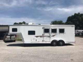 "2016 Kiefer (3) horse living quarter trailer with an 8' LSR Conversion that has an A/C unit, furnace, couch, cabinets, large closets, microwave, (2) burner cooktop, sink, 3cu fridge/freezer and a bathroom.   In the bathroom you have a toilet, shower, medicine cabinet with sink, linen closet and a walk thru door into the horse area.  In the horse area you have an interior height at 7' 6""' tall x 7' wide,"