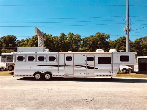 2002 Cimarron (4) horse living quarter with a 12' Trail Boss Conversion that has an A/C unit that is all air ducted, furnace, dinette that folds into a bed, tons of cabinets, sink, microwave, two burner cooktop, 6cu fridge & freezer, huge double closet and a large bathroom.