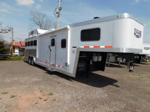 "AD#7335 2019 Logan Limited 810 GN 8' X 27' X 7'6"" 4 Horse, 10' Solid Knotty Alder LQ, 6' Slide-Out W/Sofa-Sleeper, 2 Burner Stove, Kitchen Sink, Microwave, 6 Cu Fridge, Ducted Furnace, AC, TV-DVD-AM-FM Stereo, Neo Angle Shower W/Glass Door, Porcelain Stool, Vanity W/Sink, Wardrobe W/Adjustable Shelves, Walk-Thru Door, Collapsible Rear Tack, Removable 4 Tier Saddle Rack, 4 Tier Blanket Bar, Bridle Hooks, 4 Drop Down Windows W/Fold Down Bars, 4 Large Sliding Rump Windows, Escape Door"