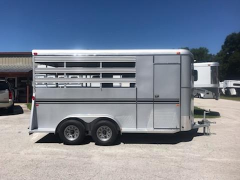 "2019 Bee (3) horse slant load bumper pull trailer with a tack room that has removable saddle racks, bridle hooks and a swinging tack room wall.  The horse area has an interior height at 7'6"" tall x 6' 8"" x 16' long, escape door, rubber mats and a full swinging rear door!  The exterior has two 3500lbs axles and a spare tire.   LIFETIME WARRANTY on the Floor!"