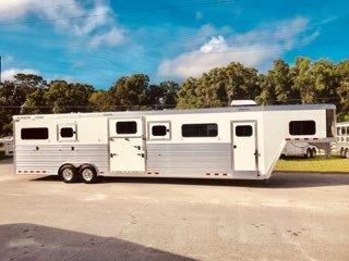 2019 Cimarron (6) horse head to head trailer with a front tack room that has an A/C unit, wired for 110V, extra cloth bar, extra interior LED Lighting, removable/adjustable saddle racks, 4 blanket bars, chest/butt bar storage, insulated roof, large sliding bus windows in the tack room wall and a brush box.  The horse area has an interior height at 8' tall x 8' wide,  California Stalls with Full Height Head Shields,