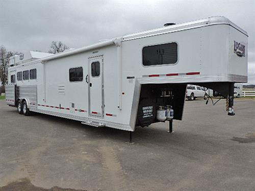 "Ad#7526  2019 Logan Coach 4H GN 8'x33'x7'6"" Limited Side Load w/Ramp, 14ft Solid Knotty Alder LQ, 6ft Slide Out, Dinette & Sofa, 6 cu ft Ref, Large Microwv, 24"" TV, DVD Player, AM/FM/CD Player, 2 Burner Stove, Dble Kitchen Sink, Overhead Cabinets, A/C, Ducted Furnace, Porcelain Stool, Neo-Angle Shower w/ Glass Door, Walk-thru-Door, Electric Awning, Dual"