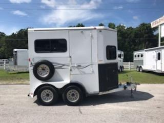 "(REDUCED 07/12/19) 2007 Titan (2) horse straight load bumper pull trailer with an interior height at 7'6"" tall x 7' wide, drop down windows at the horses heads with drop down aluminum bars, feed mangers with tack storage underneath, (2) escape doors, rubber mats over wood floor and double back rear doors!  Spare tire."