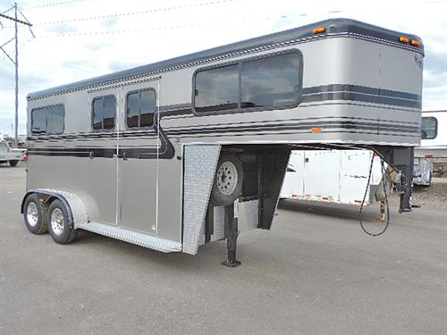 "#83616   2008 Hawk 2H GN  Straight Load, 7'6"" Tall, 4 ft Dress Room, 2-Post Saddle Rack, Bridle Hooks, Carpet GN–Drop & Floor, Bulkhead Windows, Padded Breast-Butt Bars & Divider, 2 Escape Doors, Body Windows, Double Rear Doors w/Windows & Ramp Behind, Dress Room & Horse Area Lined & Insulated–Horse Area Runner-Lined Side Walls, Rumbar Life Time Floor, Feed Bags, Load Light, Alum Rims, Roof Vents, Running Boards, Gravel Guard on BHW & Gussets.  Excellent Condition!   **Sale Price $12,900.00**"