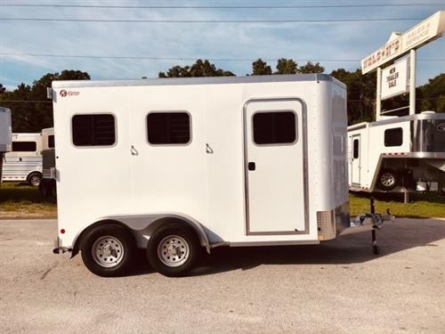 "2019 Kiefer (2) horse slant load bumper pull trailer with a front tack room that has bridle hooks, room for a (2) tier saddle rack and a camper door!  The horse area has an interior height at 7'6"" tall x 7'2"" wide, fully insulated roof, roof vents, drop down windows at the horses heads with drop down aluminum bars, sliding bus windows at the horses hips, rubber mats over all aluminum floor,  collapsible rear tack"