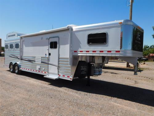 "AD#18766 2019 Elite GN 8' X 26'8"" X 7'6"" DLX 3 Horse W/12'8"" Outback Customs Solid Knotty Alder, Soft Touch Walls & Ceiling, Raised Panel Doors, Sofa-Dinette Combo, Convectional Microwave, Double Stainless Steel Sink, 2 Burner Recessed Stove, 6 Cu Fridge W/Raised Panel Door, Ducted A/C, Ducted Furnace, 2 Hat Racks, 2-24"" TV's, AM-FM-CD-DVD Stereo W/Inside & Outside Speakers, Blu-Ray Player, Pocket Door, Porcelain Stool, Radius Shower W/Glass Door, Double Hanging Closet"