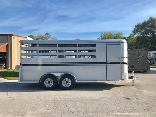2019 Bee (4) horse slant load bumper pull trailer with a tack room that has saddle racks, bridle hooks and a swinging tack room wall. The horse area has an interior height of 7' tall x 6' wide x 20' long, escape door, slatted stock sides, rubber lined walls, rubber mats over wood floor and a full swinging rear door and a half slider! Spare Tire with a LIFETIME WARRANTY on FLOOR!  Silver in color!