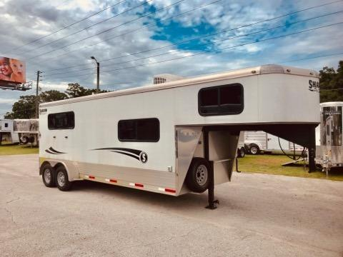 2016 Shadow (3) horse slant load trailer with a 6' front tack room that has an A/C unit, wired for 110V, picture window, insulated roof,  rubber mats over aluminum floor and a walk thru door into the horse area.  The horse compartment has an interior height at 7' tall x 7' wide, escape door, drop down windows at the horses heads and hips, insulated roof, roof vents, rubber mats over all aluminum floor,