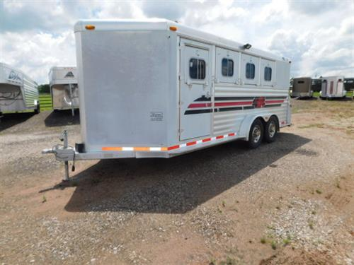 AD#1062B 2003 4Star BP 7' X 18' X 7' 4 Horse V-Nose Dress Room, Blanket Bars, Bridle Hooks, Brush Tray, 4 Drop Down Windows W/Face Nets, Escape Door, Full Width Rear Ramp, Permanent Rear Tack, 4 Tier Saddle Rack, Bridle Hooks, Stud Divider, Padded Dividers, Interior Lights, Roof Vents, Lined & Insulated Walls, Floor Mats, Load Lights. Trailer Is In Good Condition! Trailer Has Been Fully Serviced & Ready To Go! Sale Price $14,900