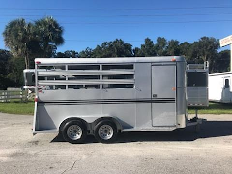 2019 Bee (3) horse slant load bumper pull trailer with a 4' dressing room that has a (3) tier removable saddle rack, bridle hooks and a spare tire! The horse area has an interior height of 7' tall x 6' wide x 16' long, escape door, stock type sides, rubber mats over wood floor and a full swinging rear door! LIFETIME WARRANTY on the trailer floor!!!! Silver in color!