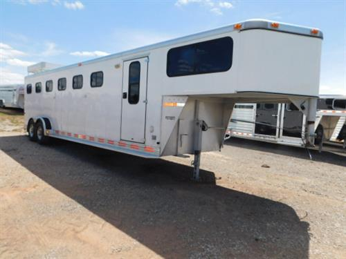 "AD#692 1997 Sundowner GN 7' X 27' X 7' DLX 6 Horse, 2'3"" To 6' Dress Room, Carpeted GN-Drop-Floor, 4 Tier Saddle Rack, Bridle Hooks, Blanket Bar, Brush Tray, Cloth Rod, Breaker Box W/110 Outlet, Lined & Insulated Roof, 50/50 Rear Doors, Drop Down Windows, Large Sliding Rump Windows, Grilled & Padded Stud Divider, Slam Latch Padded Dividers, Lined & Insulated Roof & Walls, Floor Mats, 6 Roof Vents, Interior Lights, Load Light, Double Tail Lights, Reverse Lights"