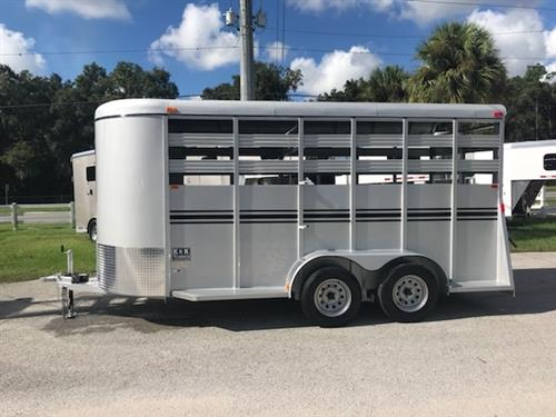 2020 Bee 16' stock bumper pull trailer with an interior height at 7' tall x 6' wide x 16' long, escape door, full swinging center gate, rubber mats over wood floor and a full swinging rear door with a half slider. The exterior has two 3500lbs axles and a spare tire. Silver in color and a LIFETIME WARRANTY on the FLOOR! Silver in Color.