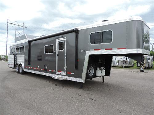 "#7648   2019 Logan Limited 814 GN 8' X 31' X 7'6"", 3 Horse Side-Load,  Full Rear Tack, 14' Solid Knotty Alder, 8' Slide-Out W/Dinette, Storage Under Dinette, Sofa-Sleeper, 2 Burner Stove, Double Kitchen Sink, 6 Cu. Fridge, Large Microwave, TV-DVD-AM-FM-CD Stereo, AC, Ducted Furnace, Neo-Angle Shower W/Glass Door, Vanity W/Sink, Porcelain Stool, Large Wardrobe W/Adjustable Shelves, Walk-Thru Door, Side Load W/Ramp & Single Stall Entry Door"