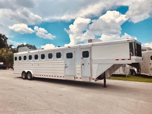"2008 Diamond (8) horse slant load trailer that has an A/C unit, toilet, sink, cabinets, closets and wired for 110V.  The horse area has an interior height at 7'6"" tall x 8' wide, escape door, drop down windows at the horses heads and hips, roof vents, stud divider at the first stall, all other dividers have hanging rubber mats, rubber lined walls, rubber mats over all aluminum floor, side rear tack compartment,"