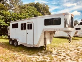 "2004 Featherlite (2) horse straight load trailer with a front tack room that has an insulated roof lined with wood, saddle racks, bridle hooks, boot box, screen door and a walk thru door into the horse area.   The horse area has an interior height at 7'6"" tall x 7' wide x 14' long, drop down windows at the horses heads with drop down aluminum bars and removable screen"