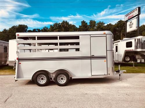 2020 Bee (3) horse slant load bumper pull trailer with a 4' dressing room that has a (3) tier removable saddle rack, bridle hooks and a spare tire! The horse area has an interior height of 7' tall x 6' wide x 16' long, escape door, stock type sides, rubber mats over wood floor and a full swinging rear door! LIFETIME WARRANTY on the trailer floor!!!! Silver in color!