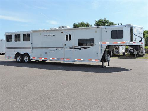 "#87580   2012 Lakota Charger 3H GN. 8'X29'X7'6"" Tall. 15' LQ w/6'Slide, Dinette in Slide, Sofa , Rear Kitchen , Lg Refrig, 2-Burner Stove, Dbl Sink, Microwv, Vented Hood, Ducted A/C, Dbl-Hang Closet, Vanity, Stool, Neo-Angle Shower w/Glass Door, Walk-thru Door, Stud Divider First Stall, Lined/Insulated Roof in Horse Area, Folding Rear Tack w/3-Tier Saddle Rack, Bridle Hooks, Step at Escape Door, 60/40 Rear Door, New Brakes, Bearings, and Tires. EXCELLENT condition!  ***Sale Price $38,900.00***"
