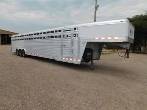 AD#3508 2014 4Star GN 8' X 38' X 7' Stock, Full Width Rear Gate W/Half Slider, 2 Center Gates, Drop Down Calf Gate, Diamond Tread Plate Floor, Interior LED Lights, Double Tail Lights, Escape Door, Electric/Hydraulic Brakes, 3-8,000 Lb Axles, 17.5 Radials + Spare. Trailer Is In Good Condition! Trailer Has Been Fully Serviced & Ready To Go! Sale Price $25,900