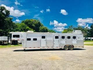 2005 Sooner (4) horse living quarter trailer with a 16' conversion that has a ducted A/C unite, T.V., stereo, corner chair, couch, cabinets, microwave, (2) burner cooktop, 6cu fridge & freezer, sink, large closets and a huge bathroom.   In the bathroom you have a Walk in Closet, sink with medicine cabinet, toilet, radius shower, large linen closet and a walk thru door into the horse area.