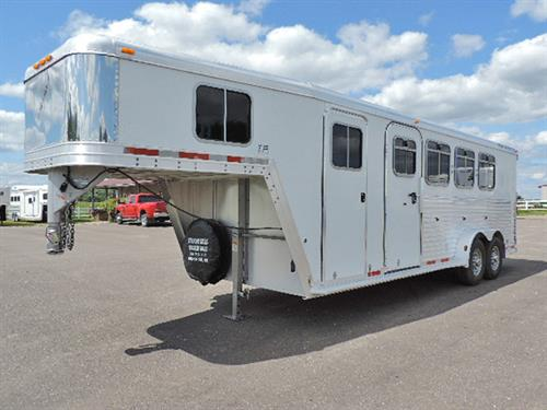 #63414  2003 Featherlite  4H GN 7'x22'x7',  4' to 8' Dressing Room, Camper Door w/ Screen, Carpet GN- Drop-to-Floor, Moveable 4-Post Saddle Rack- Front to Rear, 2 Brush Trays, Bridle Hooks, Escape Door w/ Drop-Down Feed Doors & Fold-Down Bars, Slam-Latch Dividers, Collapsible Rear Tack, Double Rear Doors w/ Windows, Full Width Rear Ramp, Stainless Steel Nose.  Trailer Serviced & Ready to Go!  Nice, Clean Trailer!   Financing & Delivery Available.  ***Sale Price $14,900.00***