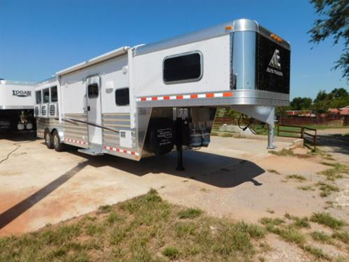 """AD#18977 2020 Elite GN 8' X 25' X 7'6"""" DLX 3 Horse W/10'8"""" Outback Customs, Solid Maple Wood, Soft Touch Walls & Ceiling, Raised Panel Doors, Dinette, Wardrobe, Conventional/Microwave, Double Stainless Steel Sink, 2 Burner Recessed Stove, 6 Cu. Fridge W/Raised Panel Door, Ducted A/C, Ducted Furnace, 2 Hat Racks, 2-24"""" TV's, AM-FM-CD-DVD Stereo W/Insides & Outside Speakers, Blu-Ray Player, Pocket Door, Porcelain Stool, Radius Shower W/Glass Door, Double Hanging Closet"""