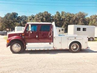 2000 International Crew Cab Truck with the 4700 DT 466E Diesel Engine with 217,600 miles, manual transmission, leather interior, stereo system, aluminum truck bed with multiple compartments for storage and a fifth wheel hitch.  Very clean truck inside and out!