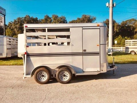 "2020 Bee (2) horse slant load bumper pull trailer with a front tack room that has saddle racks, bridle hooks and a swinging tack room wall.  The horse area has an interior height at 7' tall x 6'8"" wide, escape door, rubber lined walls, rubber mats over wood floor, full swinging rear door and a rear ramp.  The exterior has two 3500lbs axles and a spare tire."