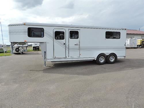 "AD#9285  2002 Trail-et 2+1 GN 4' Dr.  Rm 7'X18'X7'6"" Tall, Carpeted GN, 2 Tier Saddle Rack, Alumn. Bridle Hooks, Lg GN Windows, Blanket Bar, Camper Door w/Screen, Escape Door, Side Unload Ramp w/2 Doors w/Windows Above Ramp, Lg Body Windows, Lined & Insulated Walls in Horse Area & Dress Rm, 4 Roof Vents, Dble Rear Doors w/Full Width Ramp, Removable Padded Divider w/Padded Breast & Butt Bars, Dble Tail Lights.  Trailer Very Clean! !  Hard To Find Bargain! Won't Last Long!  Sale Price  $11,500.00"