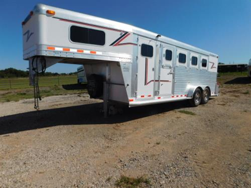 "AD#3487 2005 C&C GN 7' X 21' X 7', 4 Horse W/4' To 8' Dress Room, Bridle Hooks, Boot Box, Carpeted GN-Drop-Floor-Walls, 4 Drop Down Windows, Escape Door, Collapsible Rear Tack, 4 Tier Movable Saddle Rack, Bridle Hooks, 2 Brush Trays, Grilled Padded Dividers, Lined & Insulated Walls, Floor Mats, 2 Load Lights, 4 Roof Vents, 2-7,000 Lb Axles, 16"" Radials + Spare. Trailer Is In Excellent Condition! Trailer Has Been Fully Serviced & Ready To Go! Sale Price $15,500"