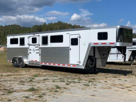 2020 Kiefer Manufacturing (4) horse head to head trailer with a front tack room that has saddle racks, bridle hooks and a camper door.  The horse area has an interior height at 8' tall x 7' wide, escape door, drop down windows at the horses heads, large sliding windows along the sides of each horse, full dividers, insulated roof, roof vents, full swinging gates making (3) box stalls, Rumber Flooring,