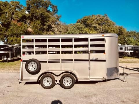 2020 Bee 16' stock bumper pull trailer with an interior height at 7' tall x 6' wide x 16' long, escape door, full swinging center gate, rubber mats over wood floor and a full swinging rear door with a half slider. The exterior has two 3500lbs axles and a spare tire. Beige in color and a LIFETIME WARRANTY on the FLOOR! Silver in Color.