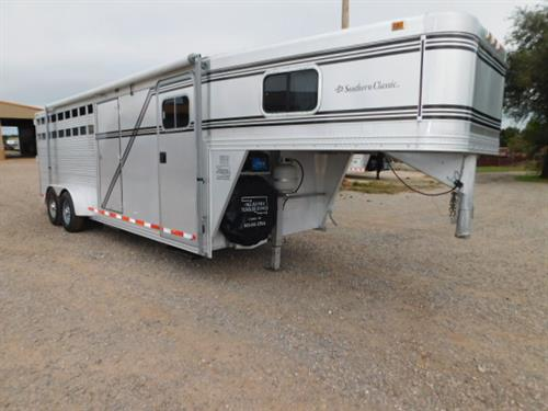 AD#8127 1999 Southern Classic GN 7' X 22' X 7', 4 Horse Weekender, 6 CU Refrigerator, Furnace, Cabinets, Bench Seat, Walk-thru Door, Drop-Down Feed Doors w/Fold-Down Bars, All-Lined Walls, Dividers, Collapsible Rear Tack, 4 Tier Swing-Out Saddle Rack, Tires Like New, Side Tack Door. Trailer in VERY Good Condition! Trailer Has Been Fully Serviced & Ready To Go! Sale Price $13,900
