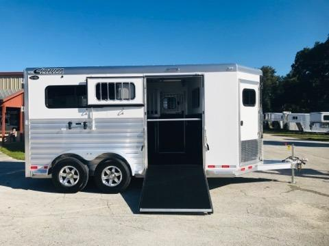 """2020 Cimarron (2) horse straight load bumper pull trailer with a front tack room that has saddle racks, bridle hooks and a brush box. The horse area has an interior height at 7'6"""" tall x 7' wide, escape door, insulated roof, roof vents, electric fans, removable divider, rubber lined & insulated walls, rubber mats over all aluminum floor, Side Ramp with dutch door and a rear ramp with dutch doors. The exterior has aluminum wheels and a spare tire."""