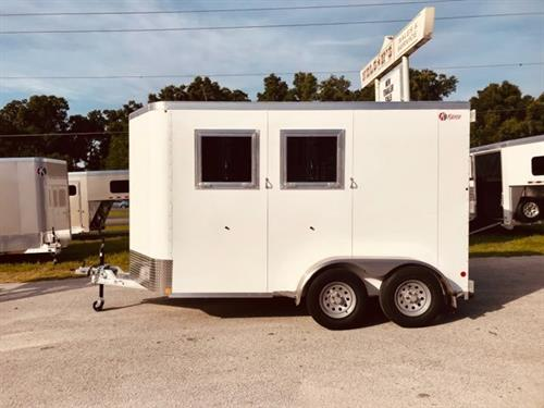 "2019 Kiefer (2) horse slant load bumper pull trailer with a front tack room that has bridle hooks, room for a (2) tier saddle rack and a camper door! The horse area has an interior height at 7'6"" tall x 7'2"" wide, fully insulated roof, roof vents, drop down windows at the horses heads with drop down aluminum bars, sliding bus windows at the horses hips, rubber mats over all aluminum floor, collapsible rear tack room"