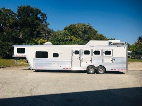 "2020 Cimarron (4) horse slant load living quarter trailer with a 12'9"" Outback Customs Conversion that has Air Ducted A/C, furnace, dinette/sofa combo, large cabinets, 6cu fridge/freezer, cooktop,  convection oven, large closets, area for a T.V. and a huge bathroom.   In the bathroom you have a tall toilet, sink with medicine cabinet, radius shower, linen closet and a walk thru door into the horse area."