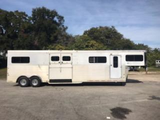 "1998 Sundowner (5) horse head to head with a front tack room that has bridle hooks and extra storage room.  The horse area has an interior height at 7'6"" tall x 8' wide, half escape door, side ramp with dutch doors, makes (3) boxes, hauls up to 5 horses, possibly 6 with the center box, all removable dividers, rubber mats over all aluminum floor and a rear ramp with dutch doors.   4 brand new tires and rims!"