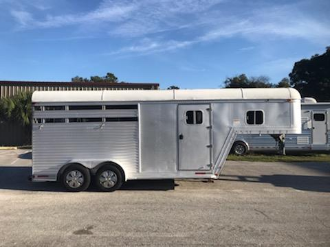 1992 Featherlite (3) horse slant load trailer with a 3' tack room that has a swing out saddle rack, bridle hooks and brush box.   The horse area has an interior height at 7' tall x 7' wide, stock sided, rubber mats over all aluminum floor and a full swinging rear door.