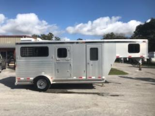 2004 Integrity (2) horse straight load trailer with a front tack room that is insulated and has a camper door.   The horse area has an interior height at 7' tall x 7' wide, feed mangers with outside storage, drop down windows with drop down aluminum bars, rubber mats over all aluminum floor and a rear ramp with dutch doors!   Under the mangers you have two pull out saddle racks with bridle hooks and blanket bars.   The exterior has one axle with a spare tire.