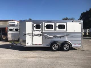 "2020 Cimarron (3) horse slant load bumper pull trailer with the ""Ready to Go Package"" that contains a swing out saddle rack, bridle hooks, clothe rod, door caddy, swing out pad rack, water tank and a walk thru door.  The horse compartment has an interior height at 7' 2"" tall x 7' wide, escape door with a drop down window, drop down windows at the horses heads and hips, insulated roof, roof vents, rubber lined & insulated walls,"