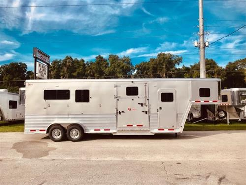 """(REORDERED) 2021 Kiefer Ext (2+1) GN Trailer with a tack room that has saddle racks, bridle hooks, brush box, braced for an A/C unit, crank up roof vent, camper door and a walk thru doo into the horse area. The horse compartment has an interior height at 8' tall x 7'2"""" wide x 24' long, escape door with a drop down window and drop down aluminum bars, drop down widows at all horses heads, insulated roof, roof vents, air flow center gates, air flow dividers, rubber mats over all aluminum floor,"""