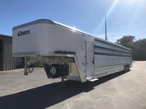 2020 Cimarron (15) horse polo trailer with a front tack room that has a 54 gallon water tank, (2) access doors with saddle racks, and a swinging tack room wall with bridle hooks.   The horse area has an interior height at 8' tall x 8' wide x 44' long, insulated roof, rubber lined walls, padded dividers, stock sides, roof vents and double back rear doors with a rear ramp.  The exterior is Air Ride Equipped