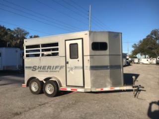 2003 TG (2) horse slant load bumper pull trailer with a front tack room that has saddle racks, bridle hooks, brush box and a camper door.  The horse area has an interior height at 7' tall x 7' wide, drop down windows at the horses heads with drop down aluminum bars, stock sided at the hips, rubber mats over wood floor and a rear ramp with air flow dutch doors!
