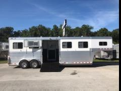(REDUCED - 11/09/2020). 2015 4star (3) box stall trailer with an interior at 8' tall x 7' wide x 25' long, double air flow gates at the nose, oversized sliding bus windows along the side of the entire trailer, roof vents, escape door with a drop down window, extra aluminum safety bars over this interior of each window, full swinging center gates fully enclosed with a center window, rubber mats over all aluminum floor, side ramp with a dutch door and a rear ramp with double back rear doors!