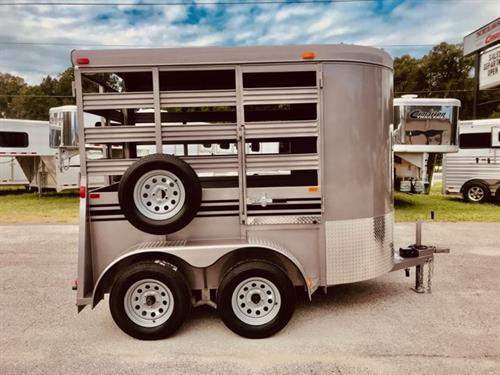 2020 Bee 10' stock bumper pull trailer with an interior height at 7' tall x 6' wide x 10' long, escape door, rubber mats over wood floor and a full swinging rear door with a half slider.   The exterior has two 3500lbs axles with a spare tire.  LIFETIME WARRANTY on the Floor!