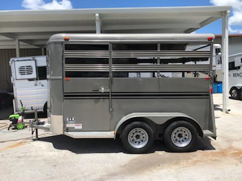 2018 Bee (2) horse slant load bumper pull trailer with a front tack room that has saddle racks, bridle hooks and a swinging tack room wall.  The horse area has an interior height at 7' tall x 6' wide, escape door, stock sided at head and hips, rubber mats over wood floor and a full swinging rear door.  The exterior has two 3500lbs axles with a spare tire.  This trailer weighs 2500lbs.