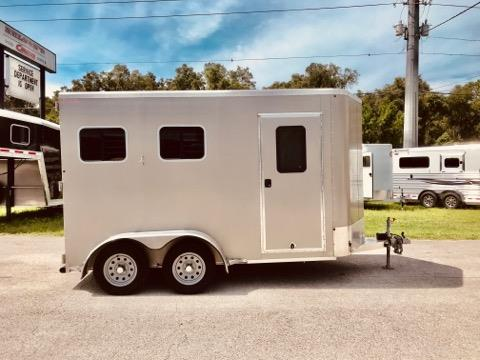 "2017 Kiefer (2) horse slant load bumper pull trailer with a front tack room that has bridle hooks, room for a (2) tier saddle rack and a camper door! The horse area has an interior height at 7'6"" tall x 7'2"" wide, fully insulated roof, roof vents, drop down windows at the horses heads with drop down aluminum bars, sliding bus windows at the horses hips, rubber mats over all aluminum floor,"